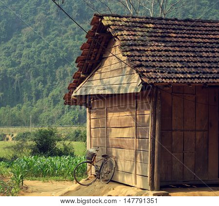Old Wooden House And Bicycle At Countryside