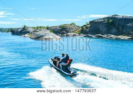 Young guy cruising on the North Sea on a jet ski