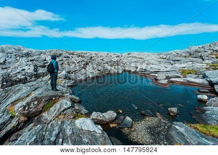 Girl Stay In Front Of Rocks Near North Sea