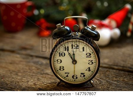 Vintage alarm clock on christmas background, holidays concept