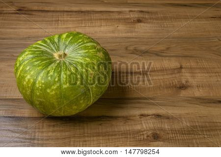 Fresh Pumpkin on Wood Concept and Idea of Food Rustic Style.