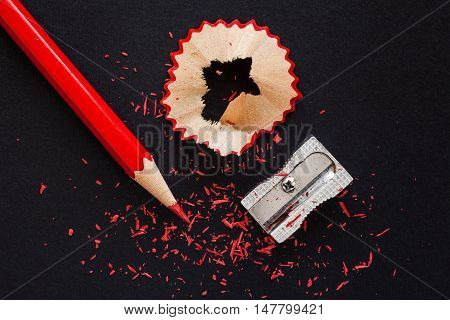 Red Wooden Pencil, Pencil Shavings And Sharpener On Black