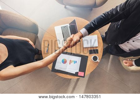 Businesspeople Shaking Hands After A Successful Meeting