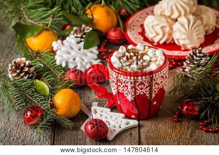 hot drink in red cup infront of christmas background