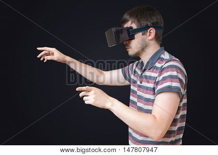 Man Is Wearing Vr Glasses And Touching Something On Black Backgr