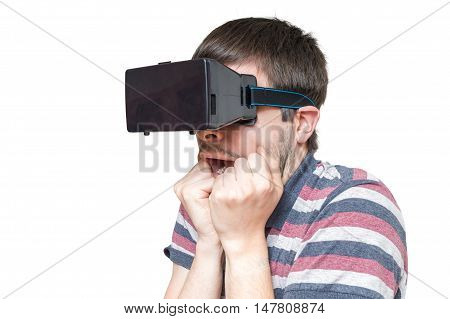 Young Man Is Wearing 3D Virtual Reality Glasses And Is Scared. I