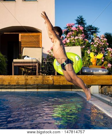 Kid jumping into the pool