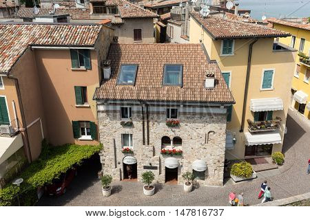 SIRMIONE ITALY - MAY 5, 2016: View of Piazza Catello from the Scaliger Castle in Sirmione Lake Garda Italy
