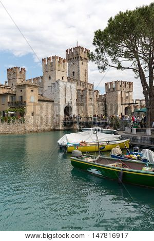 SIRMIONE ITALY - MAY 5, 2016: Sirmione - Italian small city on Garda lake with boats and castle