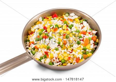 Frozen vegetable mix in small steel pan on white