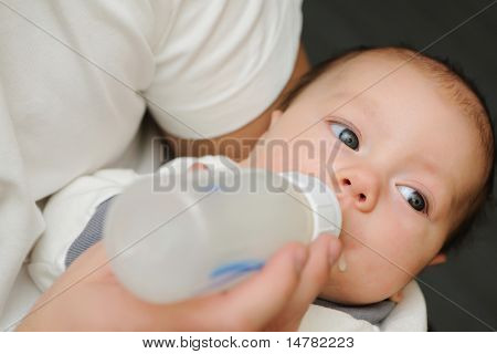 Dad feeding his newborn baby