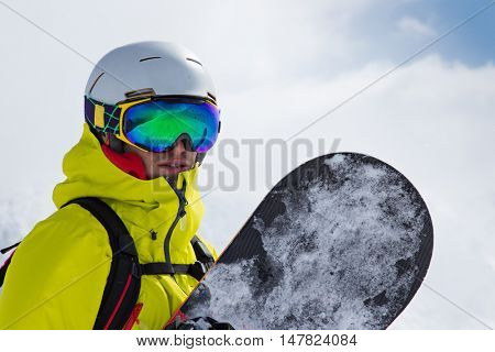 Snowboarder in high mountains.