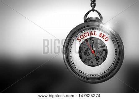 Business Concept: Social SEO on Pocket Watch Face with Close View of Watch Mechanism. Vintage Effect. Business Concept: Vintage Pocket Clock with Social SEO - Red Text on it Face. 3D Rendering.
