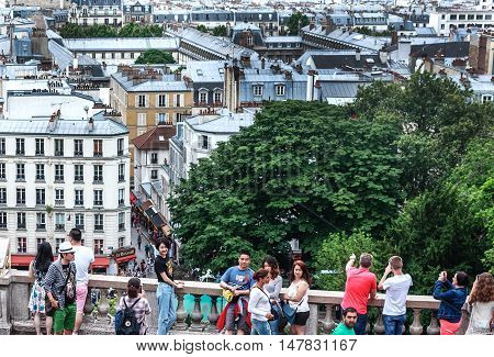 PARIS, FRANCE-JULY 28, 2016:  On the hill of Montmartre in Paris in front of Cathedral Sacre Coeur