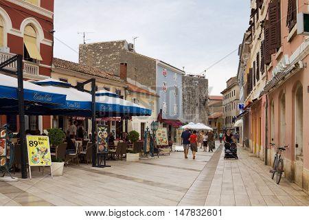 POREC CROATIA - SEPTEMBER 3 2012: A lane in the old town of Porec. Porec is a touristic town on the western coast of the Istrian peninsula in Croatia.