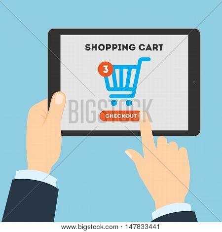 Online shopping concept. Buying products and service through Internet. Shopping cart with checkout button. Man holding tablet.