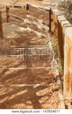 Dirt Steps And Wooden Hand Rail