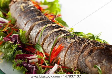 Stuffed Sliced Pike with Mixed Salad