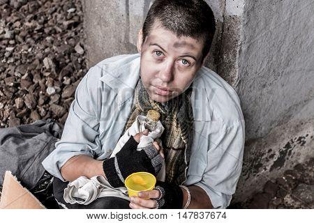 Prayerful Eyes Of Homeless Woman