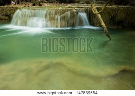 Landscape photo of beautiful waterfall in rainforest Huay Mae Kamin Waterfall in Kanchanaburi Thailand.