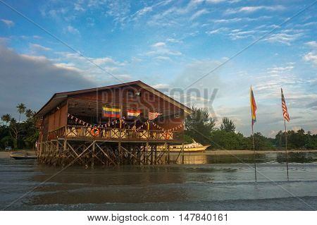 Labuan,Malaysia-Sept 17,2016:Seafood restaurant at Nagalang tropical beach during sunrise at Labuan island,Malaysia on 17th Sept 2016.One of Labuan major attractions seafood restaurants.