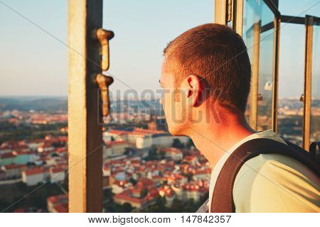Young tourist looking on the historical part of Prague Capital Czech Republic