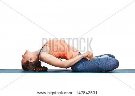 Beautiful sporty fit yogini woman practices yoga asana Matsyasana - fish pose in studio isolated on white