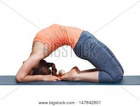 Beautiful sporty fit yogini woman practices yoga asana Kapotasana - pigeon pose intense backbend in studio isolated on white