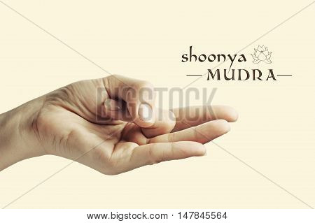 Image of woman hand in Shoonya mudra. Gesture is isolated on toned background.