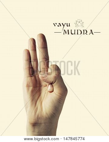 Image of woman hand in Vayu mudra. Gesture is isolated on toned background.