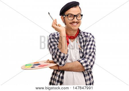 Joyful painter holding a paintbrush and a color palette isolated on white background
