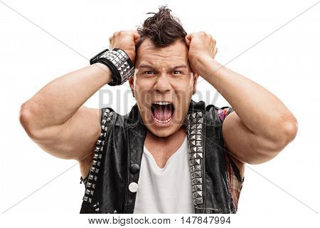 Angry punker posing with his hands on his head isolated on white background