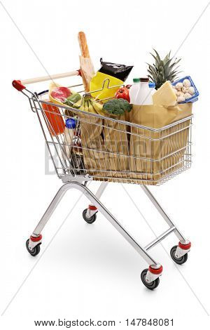 Shopping cart full of groceries isolated on white background