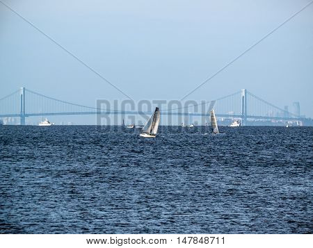Sailboats with the Verrazano Narrows Bridge in the background off the Atlantic Highlands along the New Jersey shore.