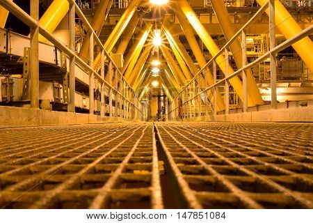 Walkway or Bridge on offshore wellhead platform for oil and gas production process, Pipeline construction on walkway, Energy and petroleum industry