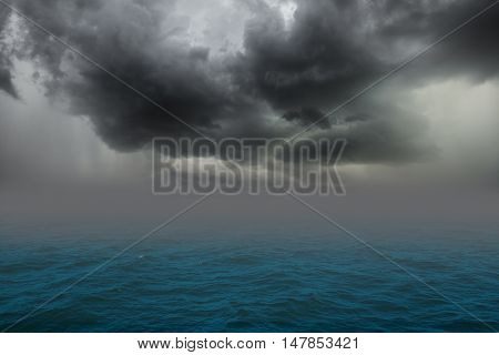 Stormy sea, abstract dark background. Storm clouds in the sky.