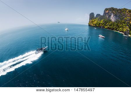 View of the island in Andaman sea with speedboat in a clear water, Thailand