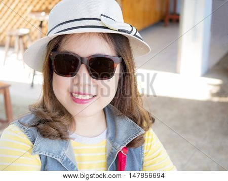 Beautiful woman wear white hat and sunglasses smile with happiness feeling