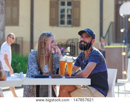Visitors To Annual Festival Of Beer Sitting At Table