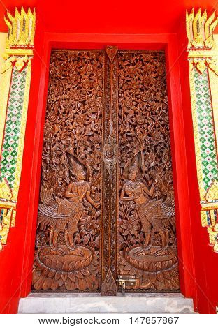The Buddhist temple door wood in Thailand.