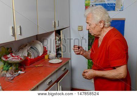 Grandmother Drinking Pill