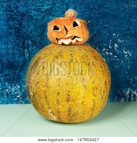 Horror at Halloween. Jack-o-lantern (pumpkin and melon)