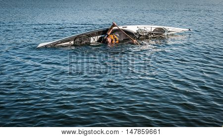 man rolling with a kayak on a lake - serial pictures 5 of 11