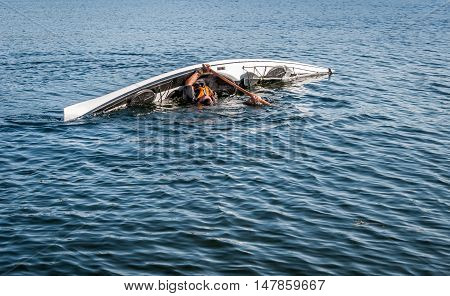 man rolling with a kayak on a lake - serial pictures 6 of 11