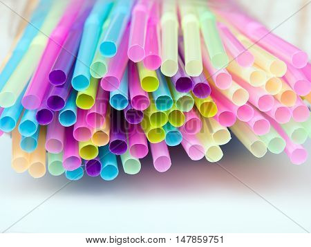 Closeup of a colorful plastic drinking straws