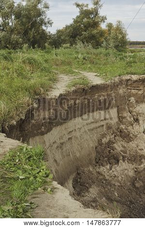 collapse dirt road on Irtish riverbank in Siberia