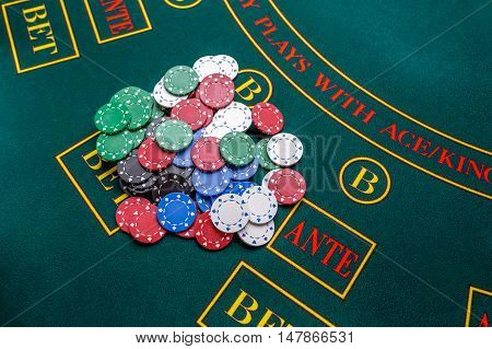 Poker chips on a poker table at the casino. Closeup. Chips winner