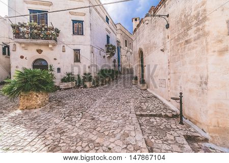 Typical Old Street View Of Matera Under Blue Sky
