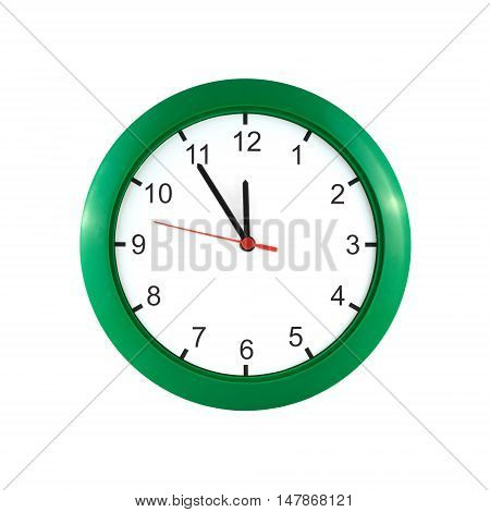 Big wall clock shows almost twelve o'clock isolated on white front view close up