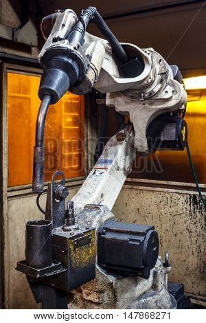 The welding robots represent the movement in the automotive parts industry